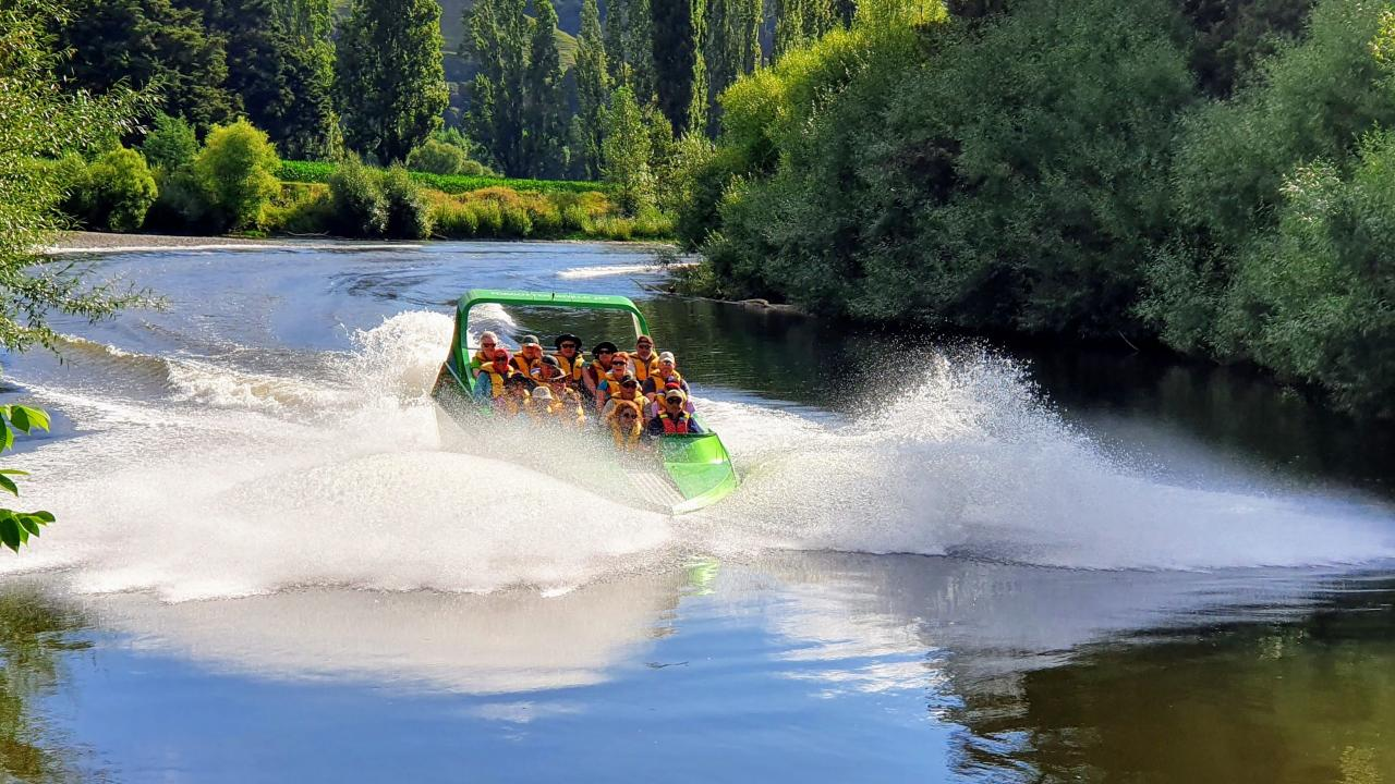 Forgotten World Adventures jet boat enjoying some fun time on the calm waters of the Whanganui River.