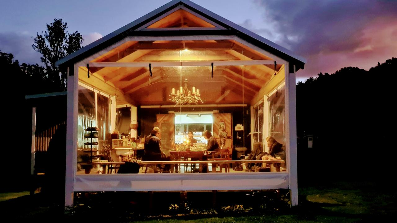 Dinner off-grid at Posh Pioneers with Forgotten World Adventures' Rhine of the Pacific tours.