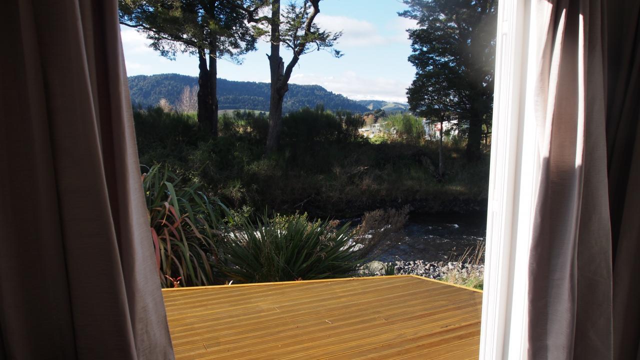 View from Mangawhero French Doors of the Mangawhero river, countryside and Mt Ruapehu.