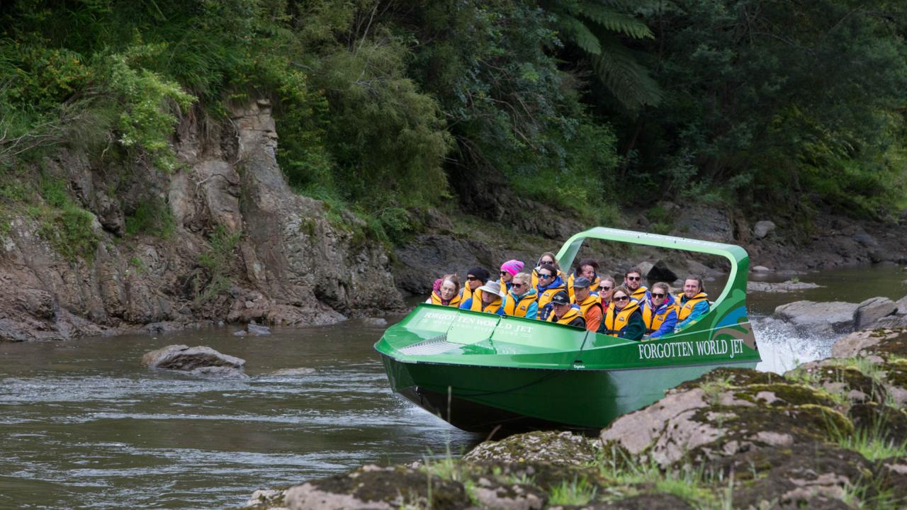 Enjoying the Whanganui River in the comfort of the Forgotten World Jet Boat.