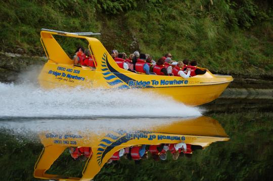 One of our Bridge to Nowhere jet boats with a group of happy clients.