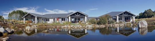 Tongariro Suites overlooking the garden pond toward Mt Ruapehu
